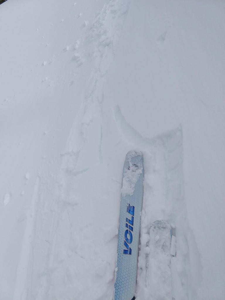 """Very small cracking in <a href=""""https://www.sierraavalanchecenter.org/avalanche-terms/wind-loading"""" title=""""The added weight of wind drifted snow."""" class=""""lexicon-term"""">wind loaded</a> terrain."""
