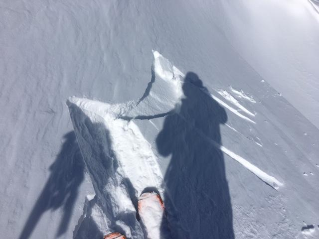 """Small <a href=""""https://www.sierraavalanchecenter.org/avalanche-terms/wind-slab"""" title=""""A cohesive layer of snow formed when wind deposits snow onto leeward terrain. Wind slabs are often smooth and rounded and sometimes sound hollow."""" class=""""lexicon-term"""">wind slab</a> cracking on test slope, 3-4&#039;&#039; deep, NE <a href=""""https://www.sierraavalanchecenter.org/avalanche-terms/aspect"""" title=""""The compass direction a slope faces (i.e. North, South, East, or West.)"""" class=""""lexicon-term"""">aspect</a>, 9650&#039;."""