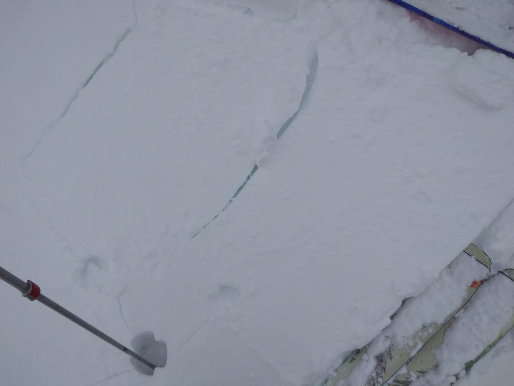 """Signs of <a href=""""https://www.sierraavalanchecenter.org/avalanche-terms/wind-slab"""" title=""""A cohesive layer of snow formed when wind deposits snow onto leeward terrain. Wind slabs are often smooth and rounded and sometimes sound hollow."""" class=""""lexicon-term"""">wind slab</a> up to 6 inches deep upon nearing summit ridge in near treeline terrain."""