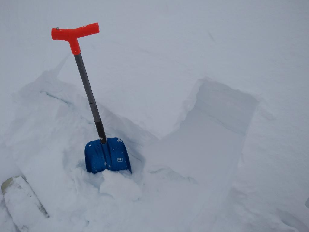 """<a href=""""https://www.sierraavalanchecenter.org/avalanche-terms/wind-slab"""" title=""""A cohesive layer of snow formed when wind deposits snow onto leeward terrain. Wind slabs are often smooth and rounded and sometimes sound hollow."""" class=""""lexicon-term"""">Wind slab</a> on summit ridge a the top of Corkscrew <a href=""""https://www.sierraavalanchecenter.org/avalanche-terms/avalanche-path"""" title=""""A terrain feature where an avalanche occurs. Composed of a Starting Zone, Track, and Runout Zone."""" class=""""lexicon-term"""">avalanche path</a>. 10 inch <a href=""""https://www.sierraavalanchecenter.org/avalanche-terms/wind-slab"""" title=""""A cohesive layer of snow formed when wind deposits snow onto leeward terrain. Wind slabs are often smooth and rounded and sometimes sound hollow."""" class=""""lexicon-term"""">wind slab</a> of <a href=""""https://www.sierraavalanchecenter.org/avalanche-terms/upside-down-storm"""" title=""""When a snowstorm deposits denser snow over less dense snow, creating a slab/weak layer combination."""" class=""""lexicon-term"""">upside down</a> snow (4F+ to F hard) on top of P+ hard crust."""