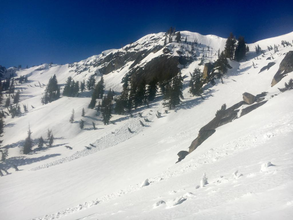 """Many previous wet <a href=""""https://www.sierraavalanchecenter.org/avalanche-terms/avalanche"""" title=""""A mass of snow sliding, tumbling, or flowing down an inclined surface."""" class=""""lexicon-term"""">slides</a>"""