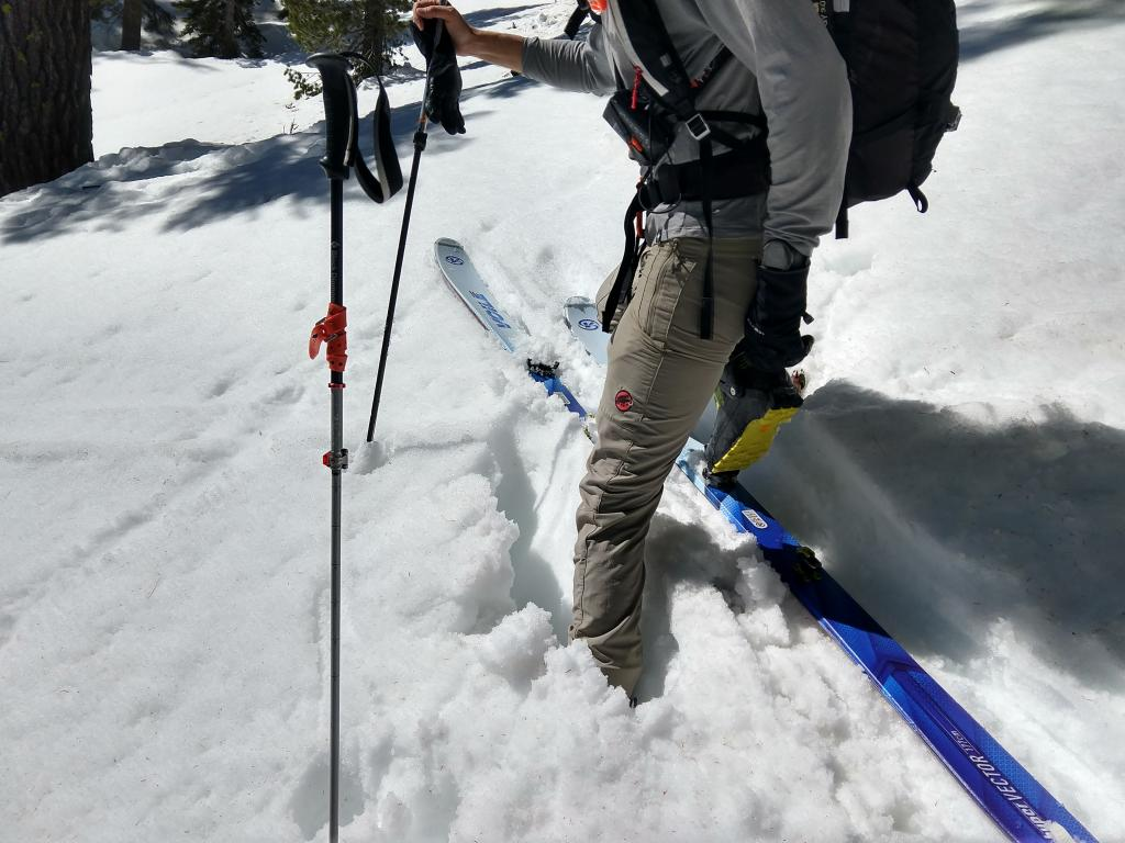 "Knee deep wet snow on an ENE <a href=""https://www.sierraavalanchecenter.org/avalanche-terms/aspect"" title=""The compass direction a slope faces (i.e. North, South, East, or West.)"" class=""lexicon-term"">aspect</a> at 8700 ft. at 10:45 am."