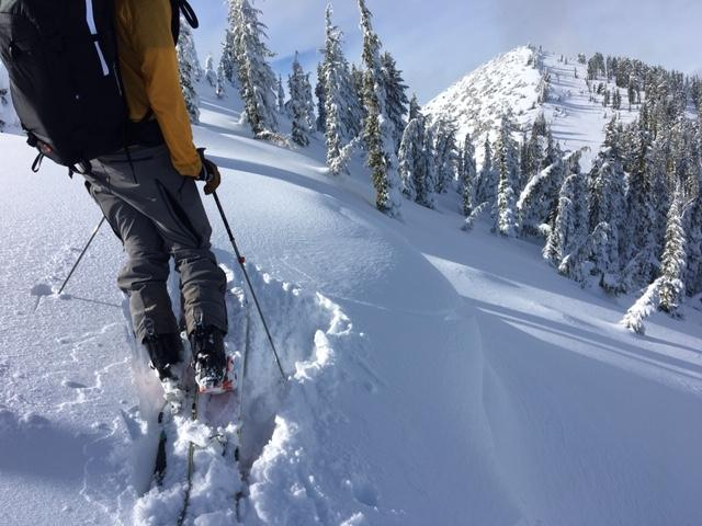 """Minor cracking with small cornices built out due to recent <a href=""""/avalanche-terms/wind-loading"""" title=""""The added weight of wind drifted snow."""" class=""""lexicon-term"""">wind loading</a>."""