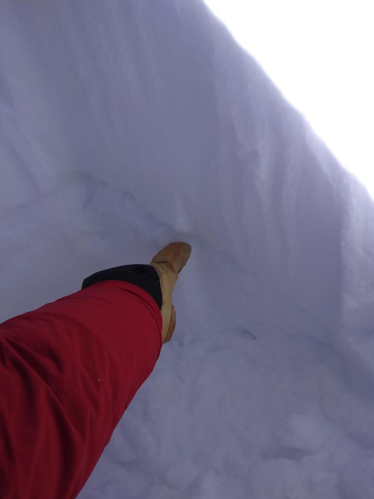 """Dec 12 <a href=""""/avalanche-terms/rain-crust"""" title=""""A clear layer of ice formed when rain falls on the snow surface then freezes."""" class=""""lexicon-term"""">rain crust</a> in the <a href=""""/avalanche-terms/snowpit"""" title=""""A pit dug vertically into the snowpack where snow layering is observed and stability tests may be performed. Also called a snow profile."""" class=""""lexicon-term"""">snowpit</a> at 9,100&#039;."""