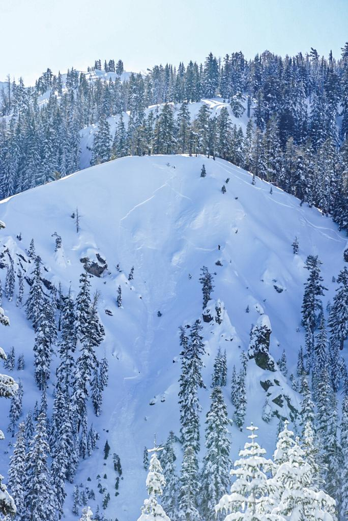"""You can see the skier on a little pitch lookers right that <a href=""""/avalanche-terms/trigger"""" title=""""A disturbance that initiates fracture within the weak layer causing an avalanche. In 90 percent of avalanche accidents, the victim or someone in the victims party triggers the avalanche."""" class=""""lexicon-term"""">triggered</a> it"""