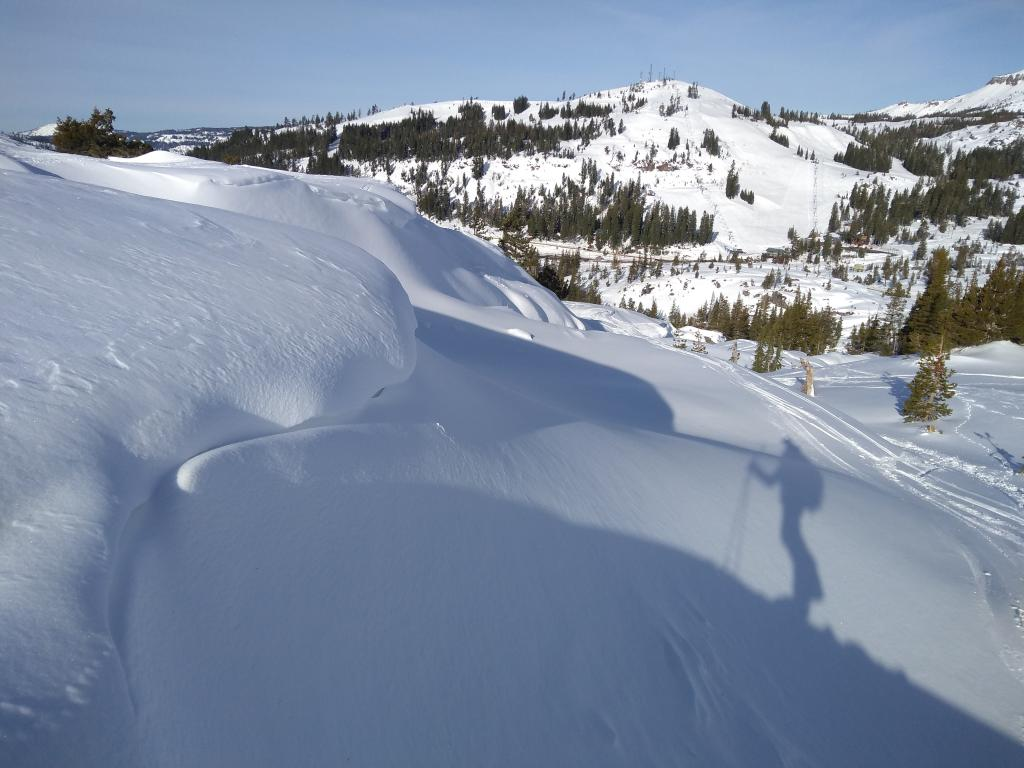 "Soft <a href=""/avalanche-terms/wind-slab"" title=""A cohesive layer of snow formed when wind deposits snow onto leeward terrain. Wind slabs are often smooth and rounded and sometimes sound hollow."" class=""lexicon-term"">wind slabs</a> lower on the peak."