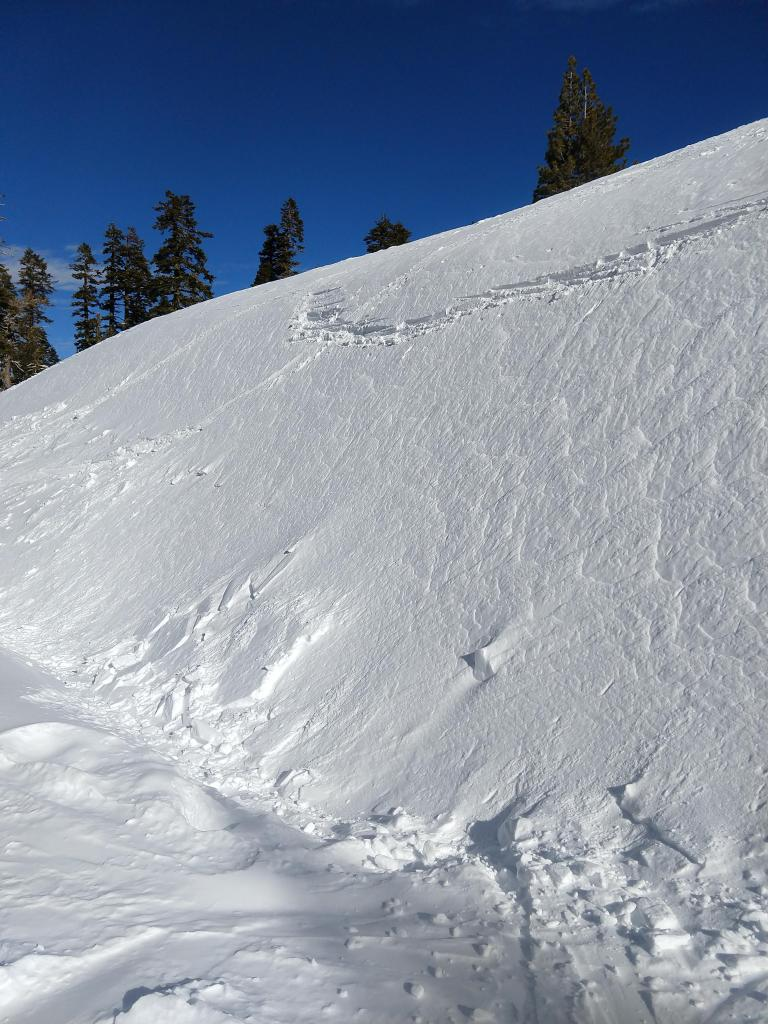 "Stubborn hard <a href=""/avalanche-terms/wind-slab"" title=""A cohesive layer of snow formed when wind deposits snow onto leeward terrain. Wind slabs are often smooth and rounded and sometimes sound hollow."" class=""lexicon-term"">wind slab</a> on a W facing test slope with some blocks of debris near the bottom."