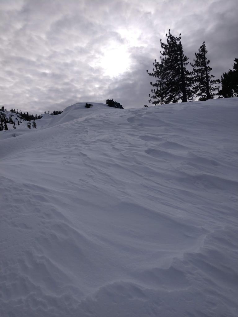 Wind scouring along ridgelines