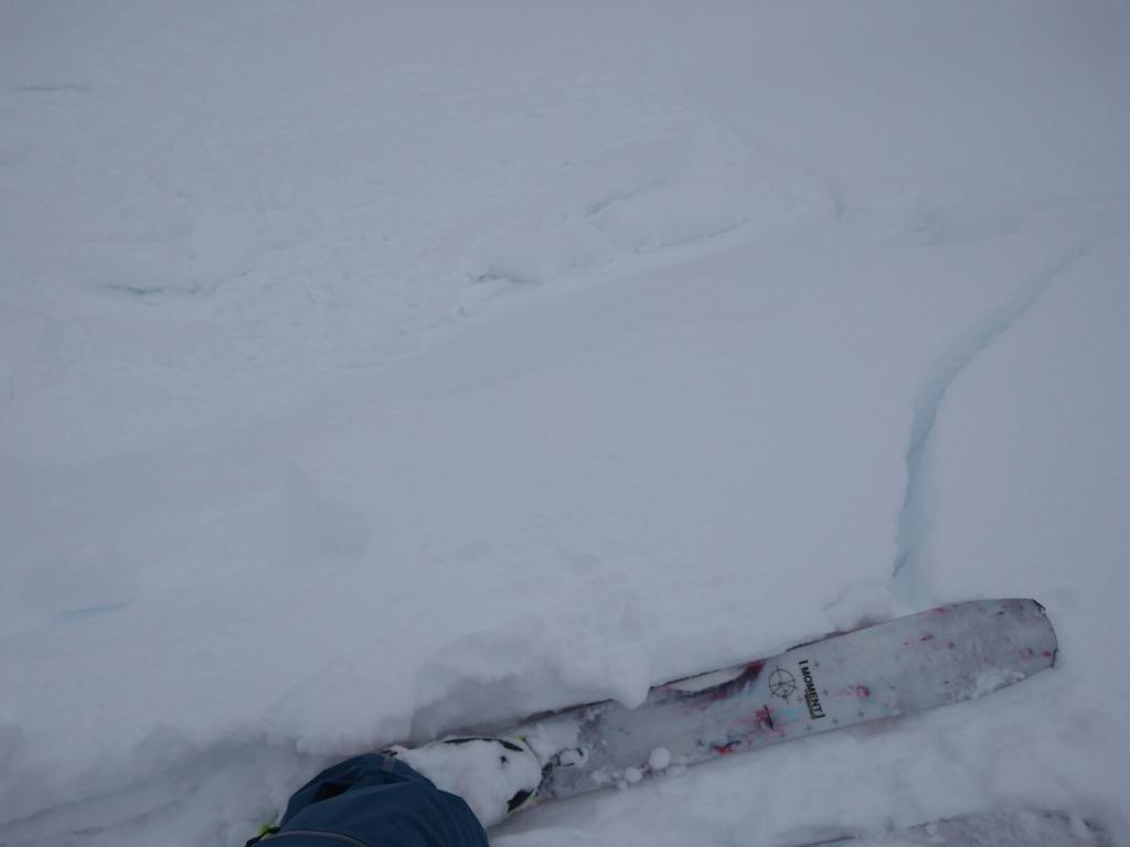"""Shooting cracks in <a href=""""/avalanche-terms/wind-loading"""" title=""""The added weight of wind drifted snow."""" class=""""lexicon-term"""">wind loaded</a> terrain"""