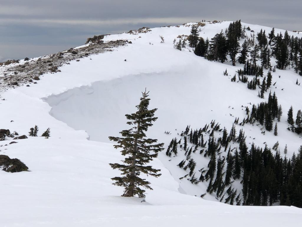 """<a href=""""/avalanche-terms/wind-loading"""" title=""""The added weight of wind drifted snow."""" class=""""lexicon-term"""">Wind loading</a> north <a href=""""/avalanche-terms/aspect"""" title=""""The compass direction a slope faces (i.e. North, South, East, or West.)"""" class=""""lexicon-term"""">aspect</a>"""