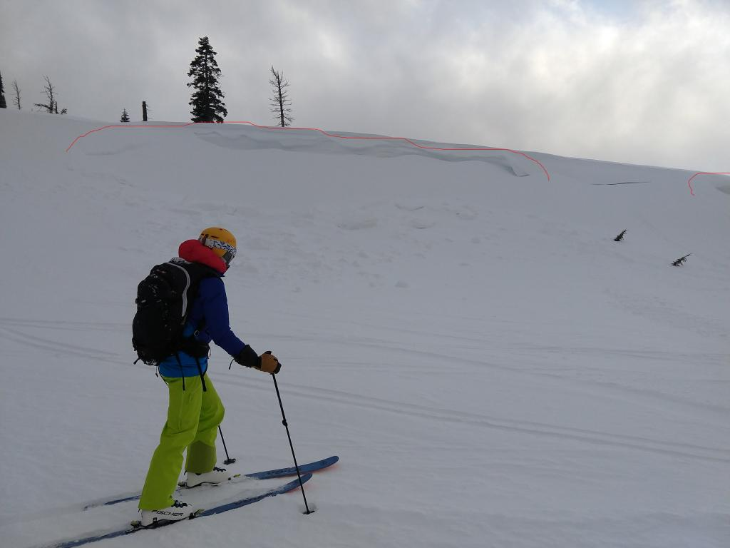 """<a href=""""/avalanche-terms/wind-slab"""" title=""""A cohesive layer of snow formed when wind deposits snow onto leeward terrain. Wind slabs are often smooth and rounded and sometimes sound hollow."""" class=""""lexicon-term"""">Wind slab</a> <a href=""""/avalanche-terms/avalanche"""" title=""""A mass of snow sliding, tumbling, or flowing down an inclined surface."""" class=""""lexicon-term"""">avalanche</a> on Wildflower Ridge"""