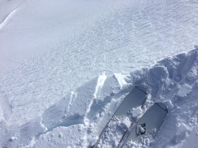 """Cracking on new <a href=""""/avalanche-terms/cornice"""" title=""""A mass of snow deposited by the wind, often overhanging, and usually near a sharp terrain break such as a ridge. Cornices can break off unexpectedly and should be approached with caution."""" class=""""lexicon-term"""">cornice</a> formation."""