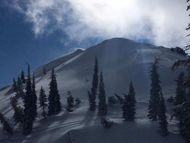 """Active <a href=""""/avalanche-terms/wind-loading"""" title=""""The added weight of wind drifted snow."""" class=""""lexicon-term"""">wind loading</a> continuing over the higher ridges and peaks."""