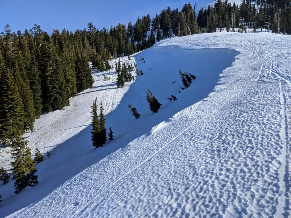 "Wind scoured scalloped firm snow on an E-NE <a href=""/avalanche-terms/aspect"" title=""The compass direction a slope faces (i.e. North, South, East, or West.)"" class=""lexicon-term"">aspect</a>."