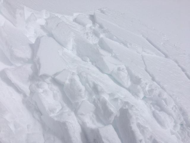 "Small <a href=""/avalanche-terms/wind-slab"" title=""A cohesive layer of snow formed when wind deposits snow onto leeward terrain. Wind slabs are often smooth and rounded and sometimes sound hollow."" class=""lexicon-term"">wind slab</a> failure on small test slope."