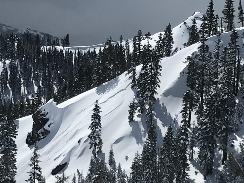 """Skier <a href=""""/avalanche-terms/trigger"""" title=""""A disturbance that initiates fracture within the weak layer causing an avalanche. In 90 percent of avalanche accidents, the victim or someone in the victims party triggers the avalanche."""" class=""""lexicon-term"""">triggered</a> <a href=""""/avalanche-terms/avalanche"""" title=""""A mass of snow sliding, tumbling, or flowing down an inclined surface."""" class=""""lexicon-term"""">Avalanche</a>"""