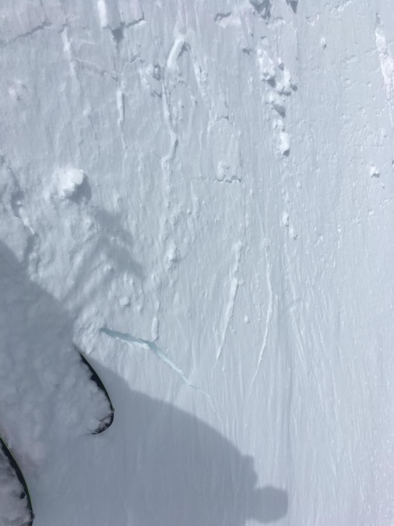 "Minor cracking on wind-<a href=""/avalanche-terms/loading"" title=""The addition of weight on top of a snowpack, usually from precipitation, wind drifting, or a person."" class=""lexicon-term"">loaded</a> test slope"