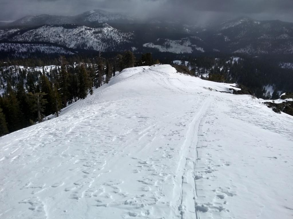 Minimal snow still available for transport on S side of E ridge of Silver Peak.