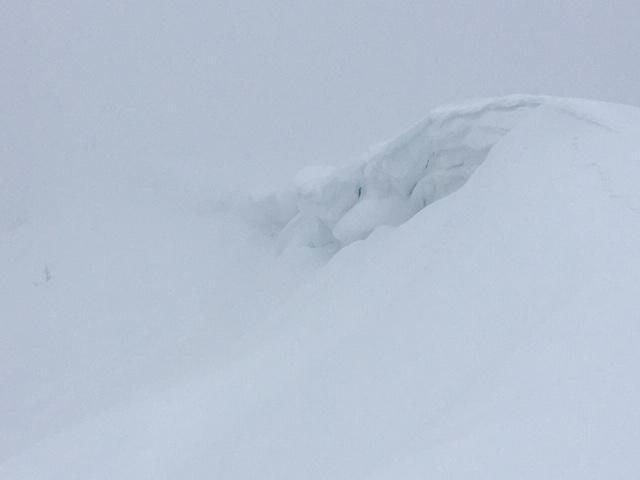 """Large built out <a href=""""/avalanche-terms/cornice"""" title=""""A mass of snow deposited by the wind, often overhanging, and usually near a sharp terrain break such as a ridge. Cornices can break off unexpectedly and should be approached with caution."""" class=""""lexicon-term"""">cornices</a> along ridgelines."""