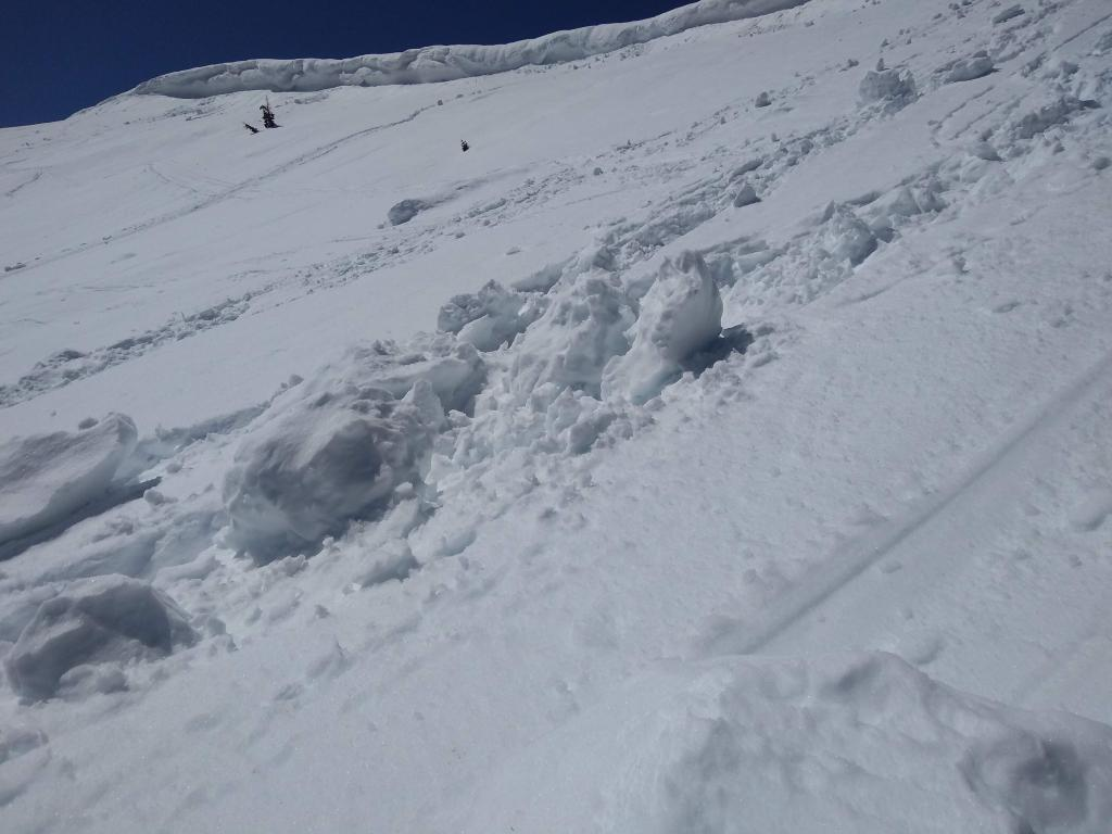 "Debris from recent <a href=""/avalanche-terms/cornice"" title=""A mass of snow deposited by the wind, often overhanging, and usually near a sharp terrain break such as a ridge. Cornices can break off unexpectedly and should be approached with caution."" class=""lexicon-term"">cornice</a> fall, likely occurred on Apr 10 or 11."