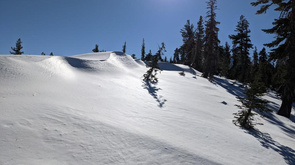 """Ridgetop drifts perched above W <a href=""""/avalanche-terms/aspect"""" title=""""The compass direction a slope faces (i.e. North, South, East, or West.)"""" class=""""lexicon-term"""">aspect</a> from previous E winds."""